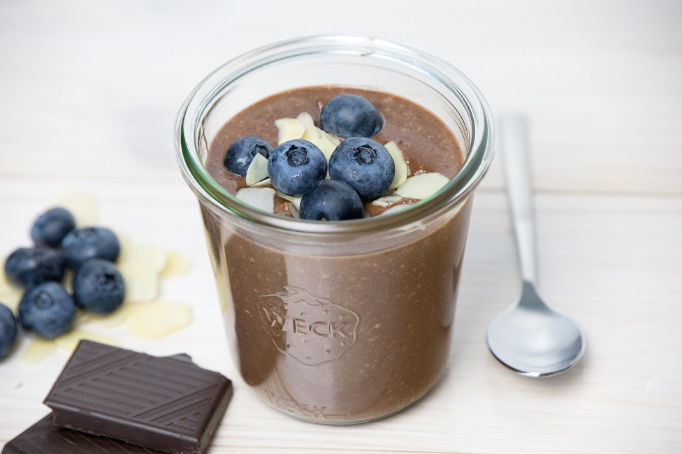 Chocolate crème with bilberries and almonds