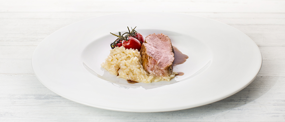 Veal loin with braised tomatoes and risotto