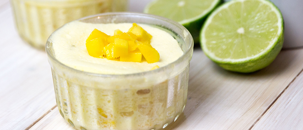 Mango soufflé with coconut and lime sauce