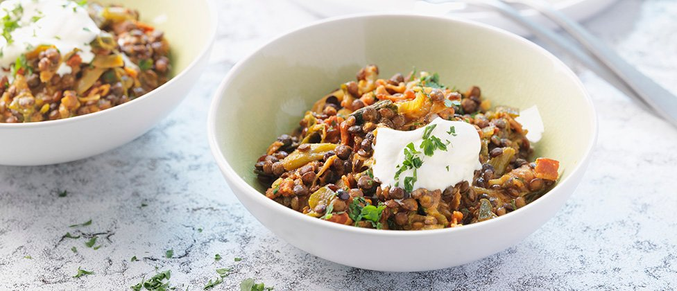 Curried lentils with peanuts and bacon